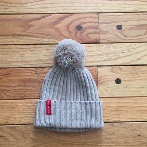 Calvin Klein winter puffball hat